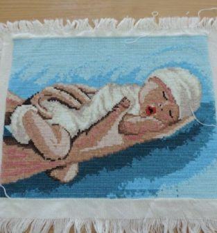 Obraz haft krzyżykowy Dziecko na dłoni